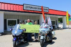 Employees present check to Rolling Thunder